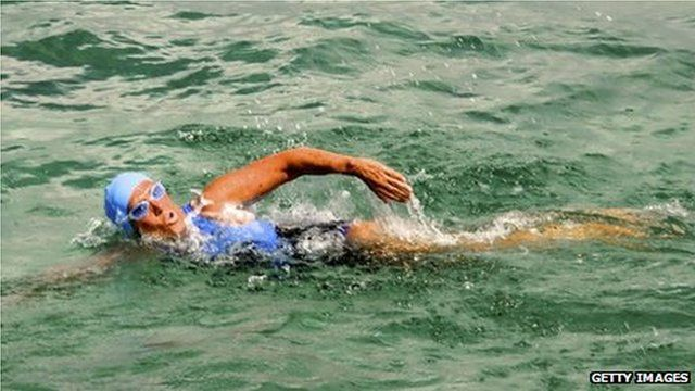 In this handout photo provided by the Florida Keys News Bureau, Diana Nyad begins her swim on August 18, 2012 in Havana, Cuba