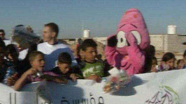 Refugees celebrate eid on Syrian border
