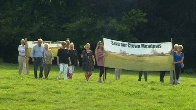 The campaign group march with banners at the park