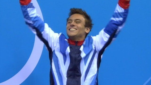 Tom Daley celebrating on the podium