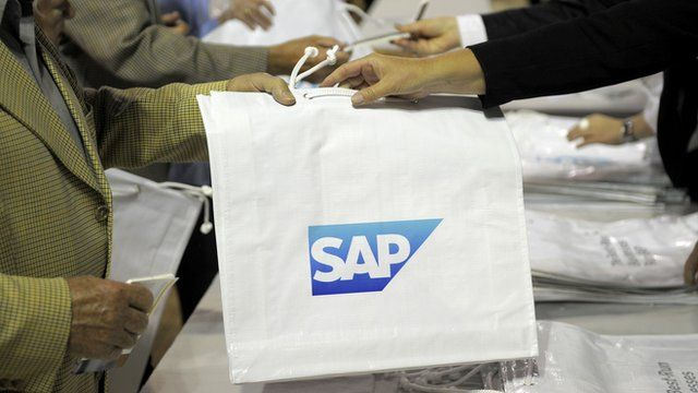 Bags with the SAP logo are distributed at an annual general meeting in Mannheim, Germany