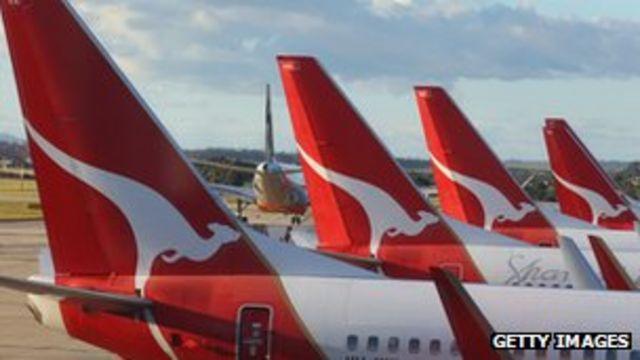 Qantas back to profit as international losses shrink