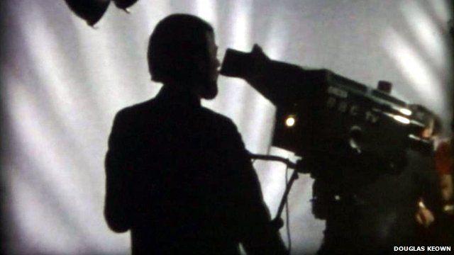 A cameraman in a BBC Aberdeen TV studio