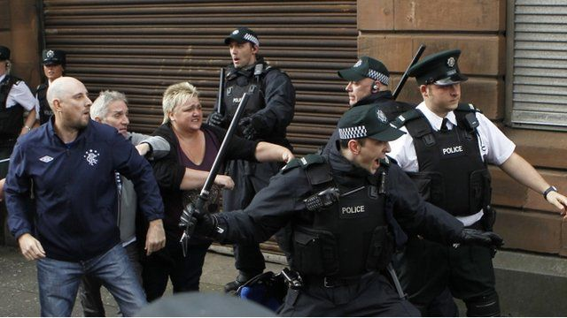 """Police officer attempt to stop fighting outside St Patrick""""s Roman Catholic Church in Belfast"""