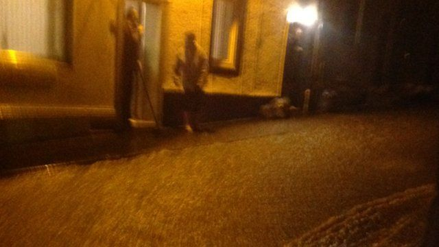 Water pouring down the road in Egremont