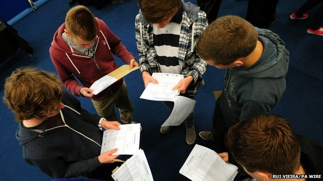 Students collect their GCSE results at the JCB Academy in Rochester