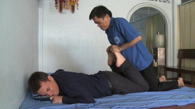 Jonah Fisher being massaged