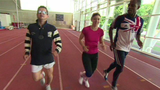 Libby Clegg and Mikael Huggins lead a blindfolded Mike Bushell through his paces