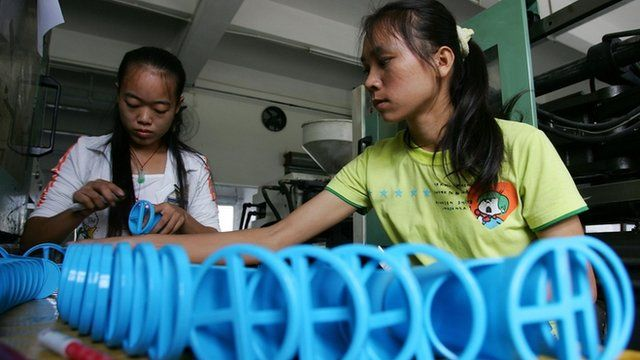 Chinese workers at a factory on the outskirts of Guangzhou in south China's Guangdong province