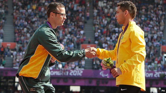 Oscar Pistorius and Alan Oliveira shake hands after receiving their medals