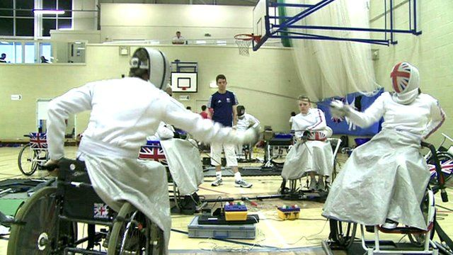 Wheelchair fencing athletes in practice hall