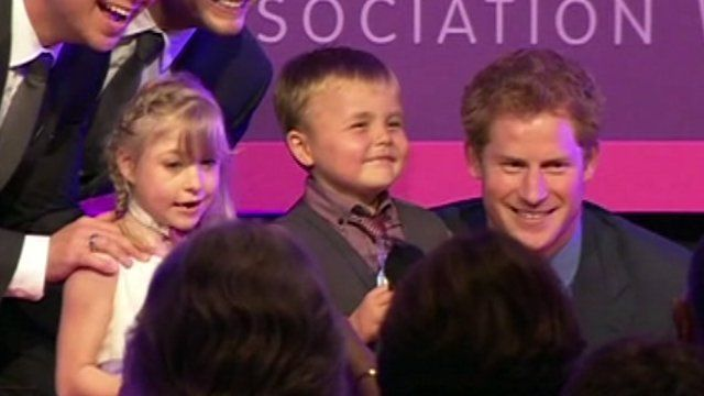 Prince Harry with children Alex Logan and Hope Hillis
