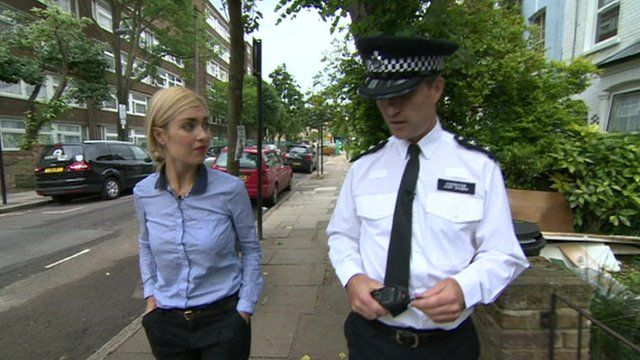 Hayley talks to a police officer in Islington.
