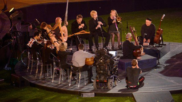 Lloyd Coleman performs with the British Paraorchestra at the 2012 Paralympics closing ceremony with Coldplay vocalist Chris Martin (seated on floor, back to camera)