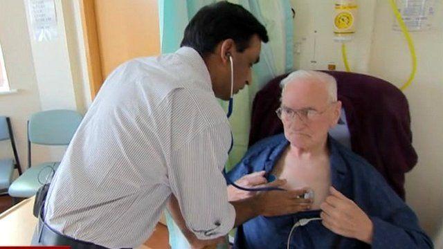 Doctor treating elderly patient