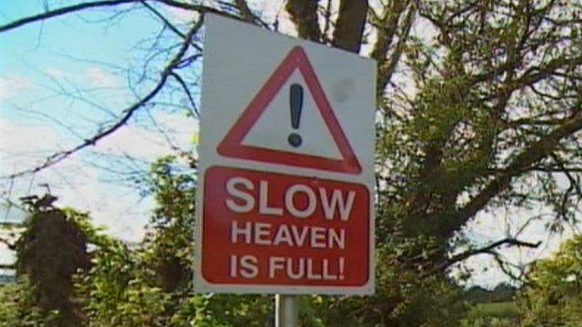 """""""Slow - Heaven is full"""" sign in Devon"""