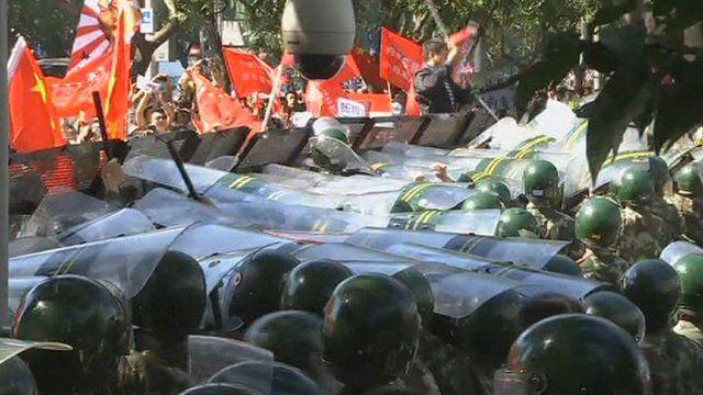 Police and demonstrators in Beijing