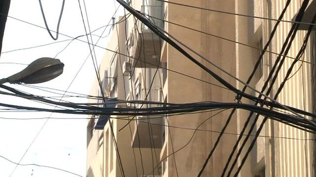 Tangle of power lines over Beirut street