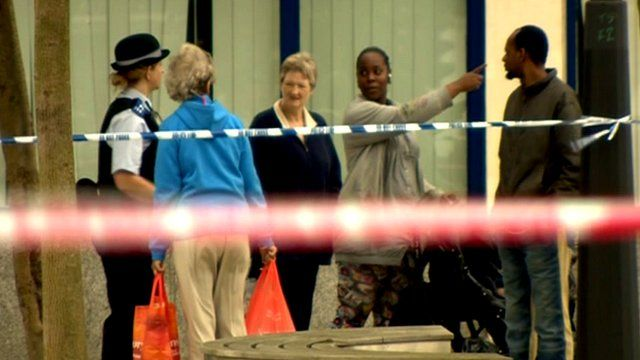 Police and residents near the crime scene in south-east London