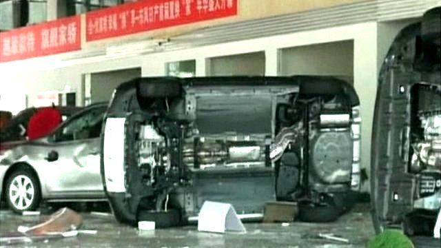 Aftermath of attack on a car showroom