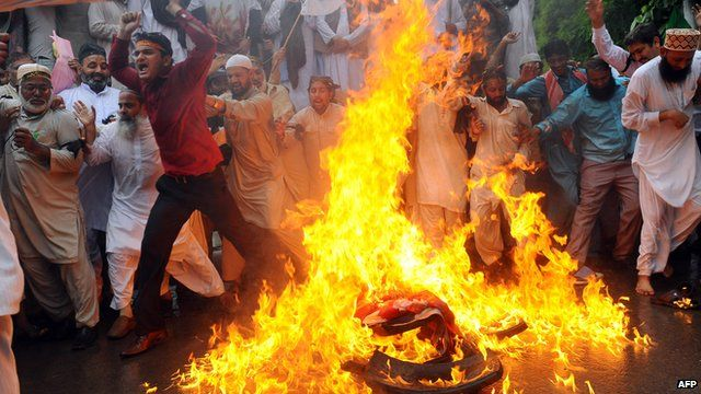 Protesters in Pakistan set fire to an American flag