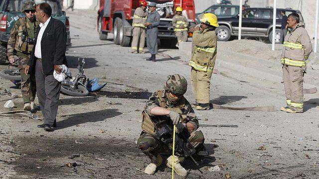 French soldier investigating the scene of suicide bombing in Afghanistan