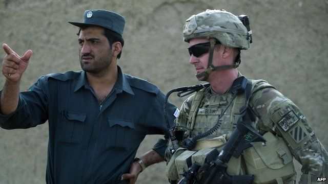 A US soldier and a member of the Afghan National Police during a joint patrol in Kandahar province