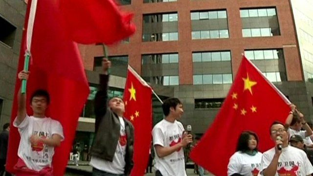 Protesters with Chinese flags