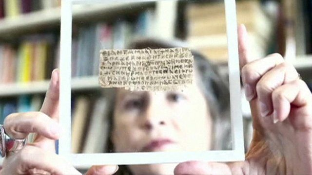 Harvard divinity professor Karen King holds the ancient scrap of papyrus