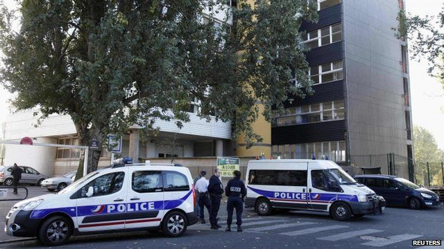 French police cars are parked in front of satirical weekly Charlie Hebdo offices in Paris