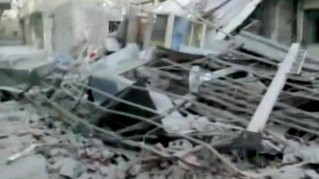 Damage believed to be in the Hajar al-Aswad suburb of Damascus, Syria