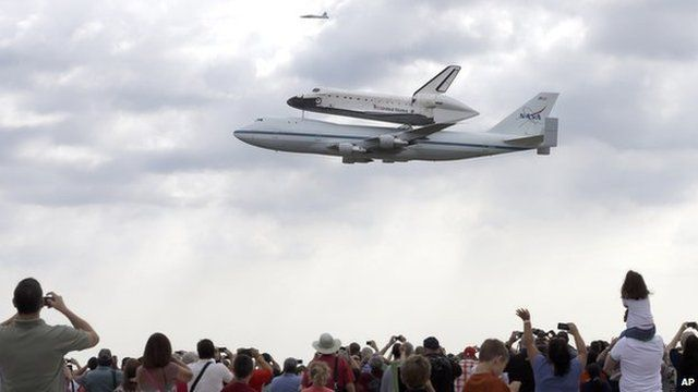 Endeavour being carried by a plane.