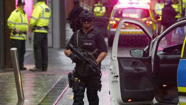 An armed police officer standing guard