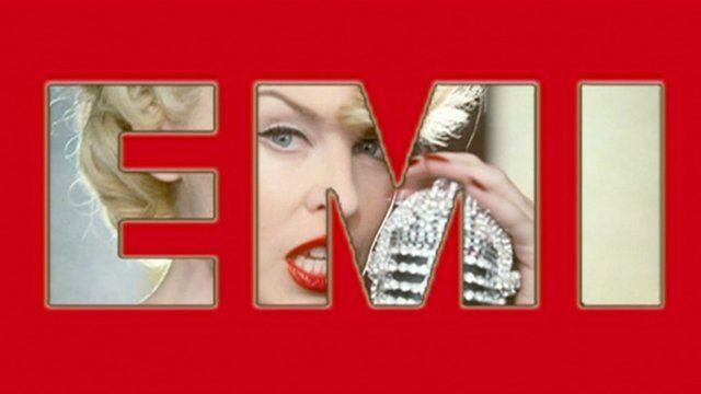 Kylie Minogue under an EMI graphic