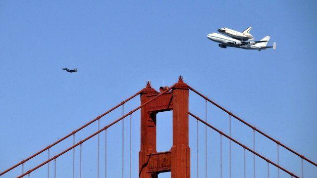 Nasa's shuttle Endeavour flying piggy-back on a Boeing 747 over the Golden Gate Bridge in San Francisco
