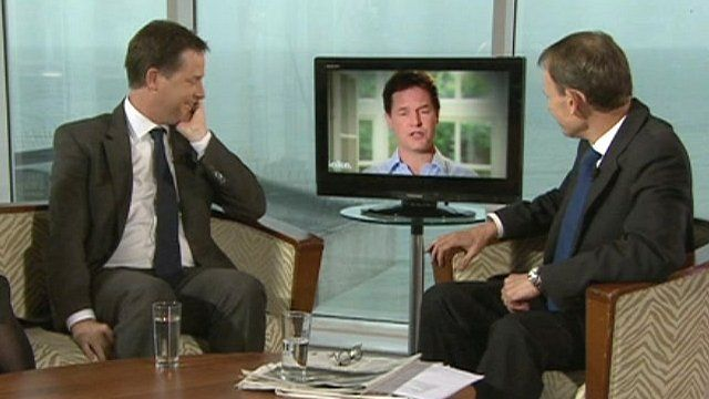 Nick Clegg watches a video of himself on The Andrew Marr Show