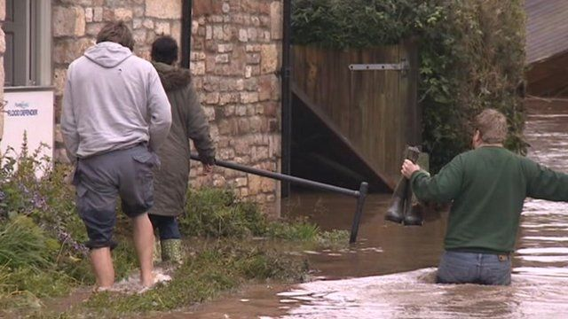 Man wading through flood water