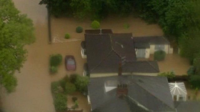Aerial shot of a car submerged in water