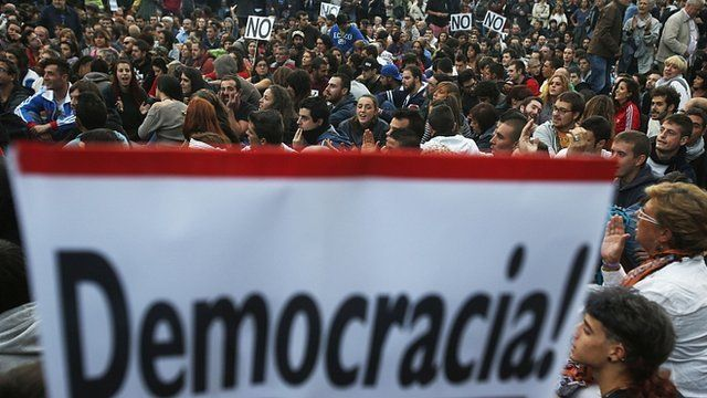 Protesters take part in a demonstration outside Madrid's Parliament