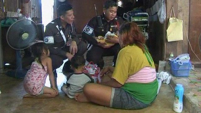Traffic policemen with a baby they delivered