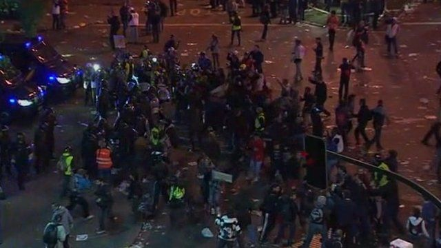 Riot police and protesters