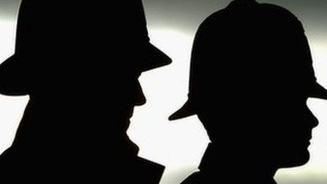 Police officers in silhouette
