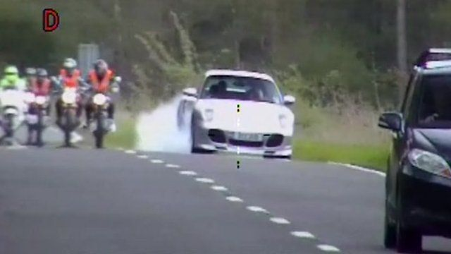 Footage of David Judd overtaking a line of motorbikes in his Porsche