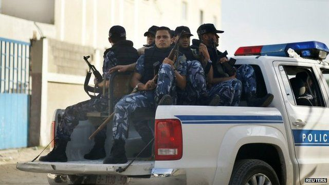 Hamas policemen guard outside a Gaza military court September 17, 2012