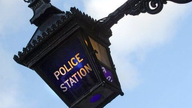 A blue lamp outside the Metropolitan Police Service police station