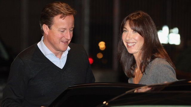 Prime Minister David Cameron arrives with his wife Samantha Cameron for the Conservative party conference