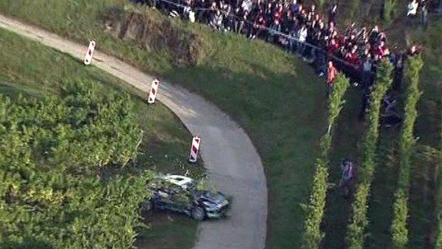 Rally car crashes through vineyard
