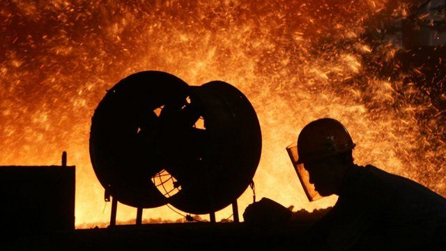 A worker at a blast furnace
