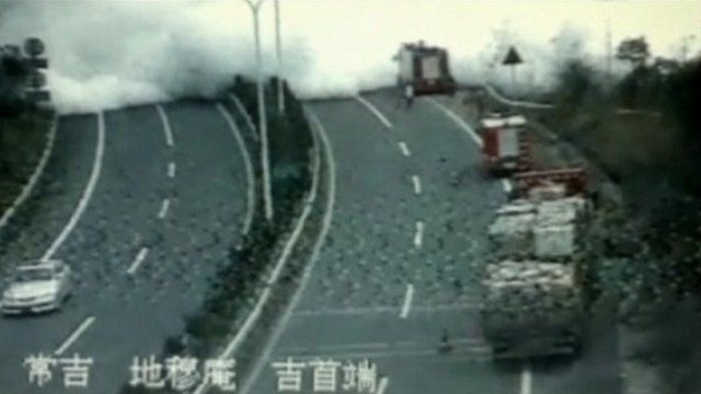Smoke spreads after a tanker explosion on a major highway in Hunan province, China