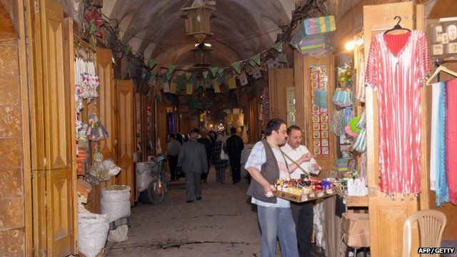 Traders and shops in the medieval souk of the old city of Aleppo in northern Syria in 2011. The ancient market, recognized by UNESCO as a world heritage site, was badly damaged in a recent fire.